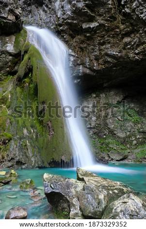Beautiful waterfall falling from a rock covered by moss. Kot waterfall, San Leonardo, Cividale del Friuli, Udine province, Friuli Venezia Giulia region, Italy. Valli del Natisone nature. Zdjęcia stock ©