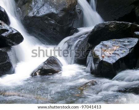 beautiful waterfall in a national park near Palolem in Goa, India - stock photo