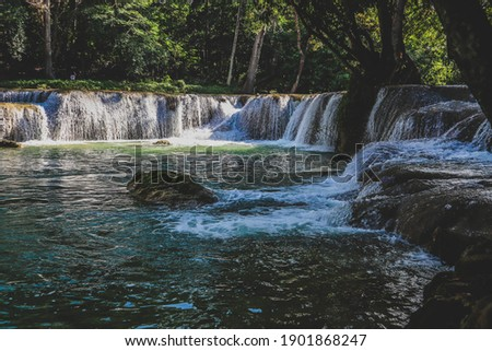 Beautiful waterfall in deep forest at Thailand. stock photo