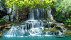 Beautiful waterfall in garden at Ratchaburi Province,Thailand.