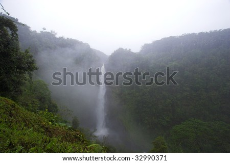 Beautiful waterfall in lush tropical Hawaii forest