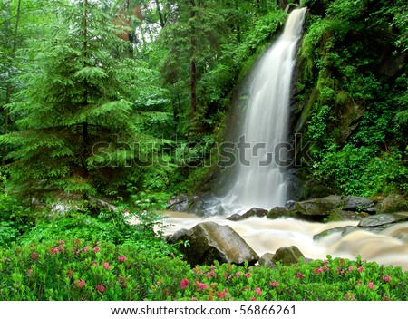 beautiful waterfall in the National Park Tercino valley in the mountains Novohradske-Czech Republic #56866261