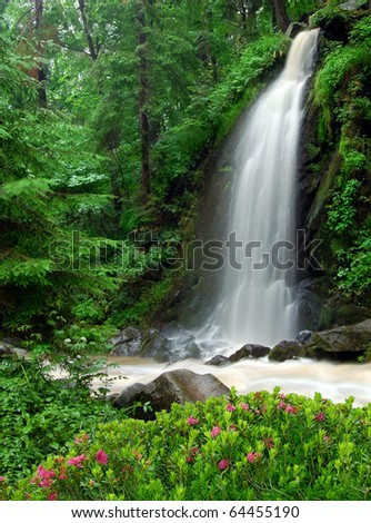 beautiful waterfall in the National Park Tercino valley in the mountains Novohradske-Czech Republic