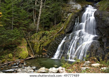Beautiful waterfall on the side on the road in Vermont in the middle of Autumn