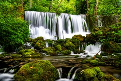 Beautiful waterfall Vrelo in the  Perucac, National park Tara, Serbia. The river is the smallest river in the world, only 365 meters.  Stones and rocks covered with green moss. Clean and cold water.