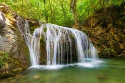 Beautiful waterfall with a blue lake
