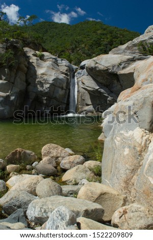 beautiful waterfall with peacefull pond and stones #1522209809