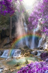 Beautiful waterfall with soft focus and rainbow in the forest