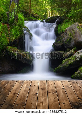 beautiful waterfall with wooden ...