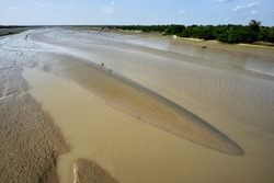 Beautiful waterscape of River Matla during the low tide in Canning, West Bengal in India