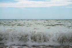 Beautiful waves on the shore. Big waves reach the beach