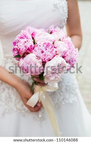 Beautiful wedding bouquet in bride\'s hand