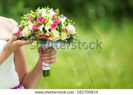 Beautiful wedding bouquet in hands of bride #185700854