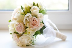 Beautiful wedding bouquet of white and pink roses.