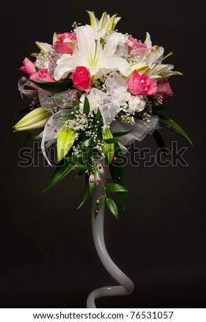 Beautiful bouquet of pink flowers on black background - stock photo