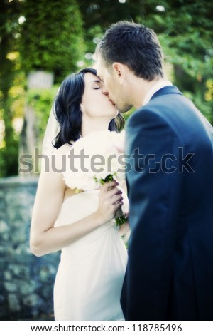 beautiful wedding bride and groom kiss - real people