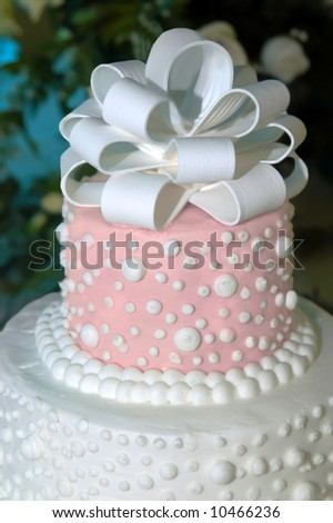 stock photo Beautiful wedding cake is in pink and white