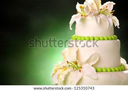 beautiful wedding cake on a green background