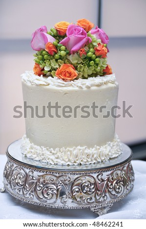 stock photo Beautiful wedding cake topper with multiple flowers