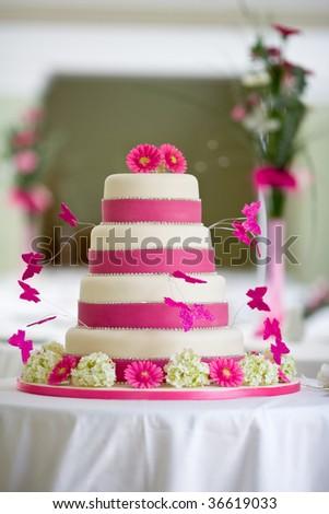 Beautiful wedding cake with butterflies - stock photo