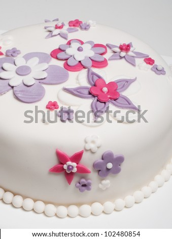 beautiful wedding cake with pink purple and white flower design