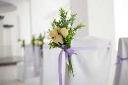 Beautiful wedding ceremony. Chairs with a white canopy and flowers