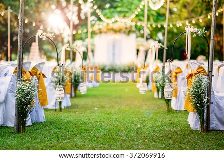 Beautiful  Wedding ceremony event in garden at sunset