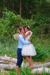 Beautiful wedding concept. Bride and groom kissing.