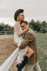 Beautiful wedding couple.  Bohemian wedding  at the ranch. Magic sunset
