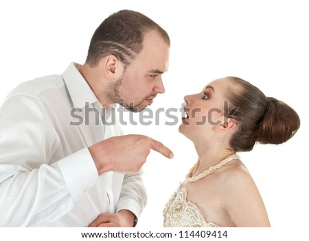 Beautiful  wedding couple  discussing over white background