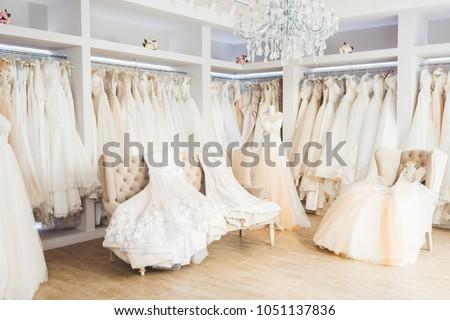 Beautiful wedding dresses on hangers in wedding atelier