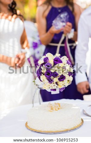 Beautiful wedding exotic bouquet with plumeria and cake
