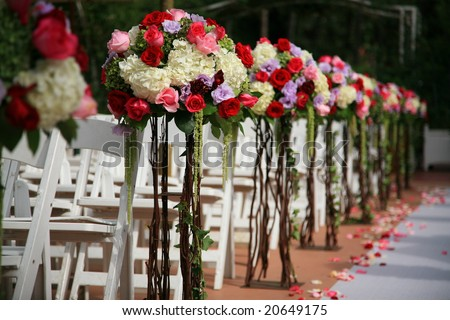 Beautiful wedding flower arrangement of seats along the aisle