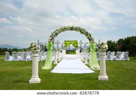 stock photo Beautiful wedding flower arrangement of seats along the aisle