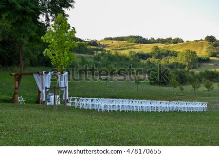 Beautiful wedding place outside, with white chairs and beautiful trees #478170655