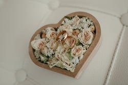 Beautiful wedding rings lie on background of a bouquet of flowers