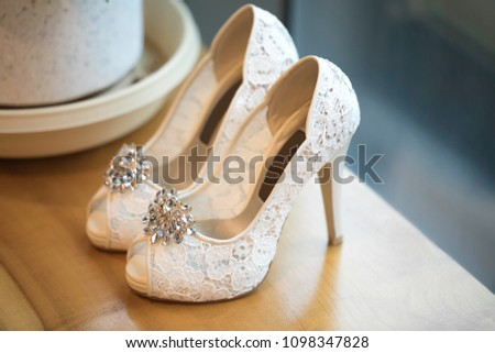 Beautiful wedding shoes in front of the window background #1098347828