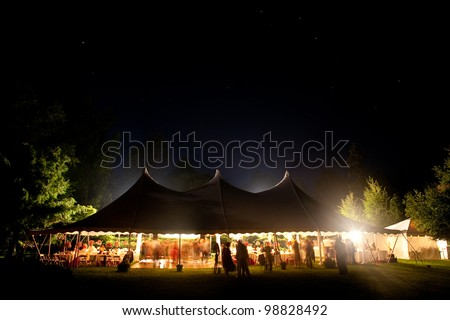 Beautiful wedding tent set up for an outdoor reception. This is a long night exposure, there is blur under the tent showing activity