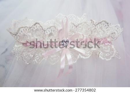 Beautiful wedding white bridal garter. Wedding day moments
