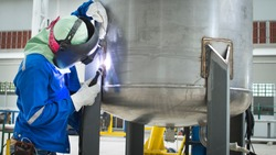 Beautiful welder welding stainless steel by process GTAW ,Welder Industrial welding part in factory or Petrochemical