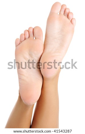 Beautiful well-groomed female a foot and a heel lifted upwards on a white background