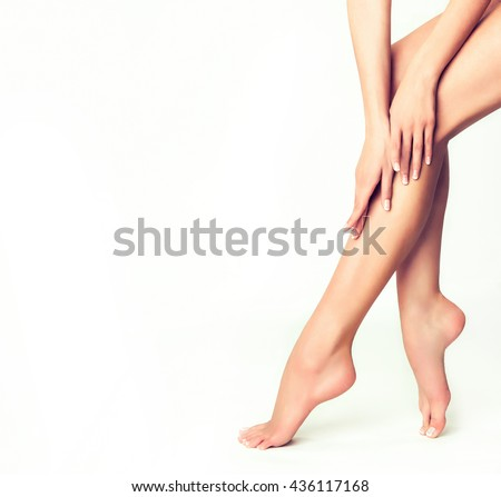Beautiful well-groomed female legs . Foot care . Depilation of hair on the feet .  #436117168