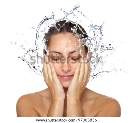 Beautiful wet woman face with water drop. Close-up portrait on white background