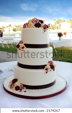 stock photo Beautiful White and Burgundy Wedding Cake With Flowers