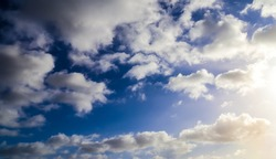 Beautiful white and fluffy clouds in a deep blue sunny sky