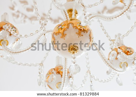 Beautiful white and gold crystal chandelier close up
