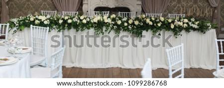Beautiful White and Green Flower Decoration Arrangement on Wedding Table. Wedding Bridal Flower Decoration.