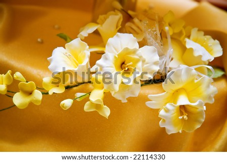 stock photo beautiful white and yellow flowers on a wedding cake