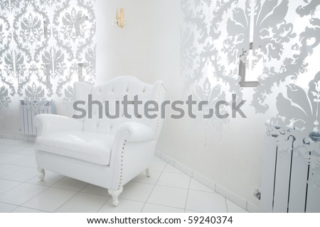 beautiful white armchair in a modern apartment