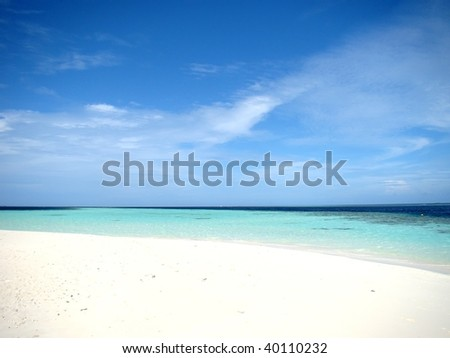 Beautiful white beach and turquoise sea at the Maldives